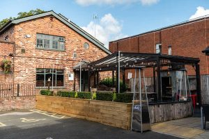 Coach & Four Pub, Restaurant & Rooms, in Wilmslow, Cheshire